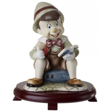 Ceramic Pinocchio Figurine On Cherry Wood Base Centerpieces