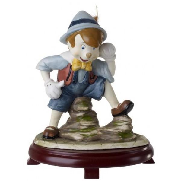Ceramic Pinocchio Figurine On Cherry Wood Base